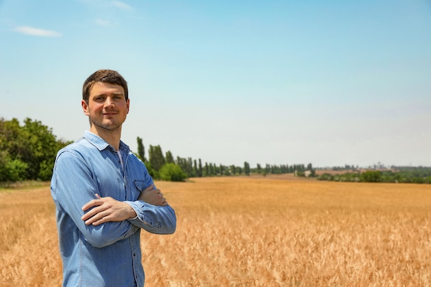 Young agronomist in barley field