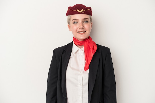 Young air hostess caucasian woman isolated on white background happy, smiling and cheerful.