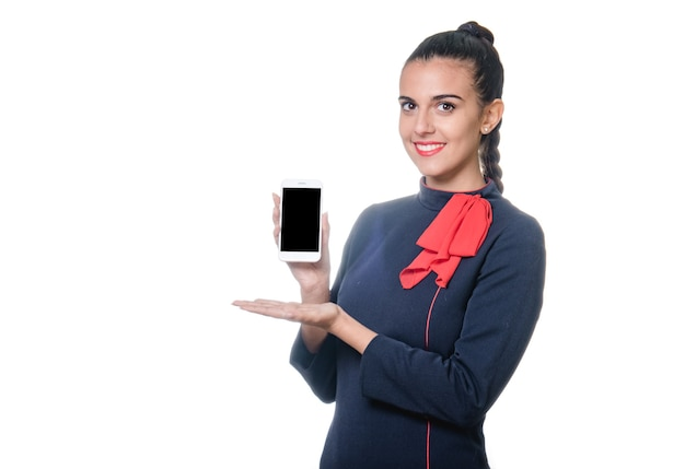Young air stewardess holding device with empty screen in hand.