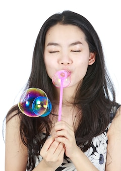 Young aisan lady blowering bubbles