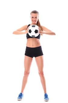 サッカーボールを持つ若い、セクシーな女の子