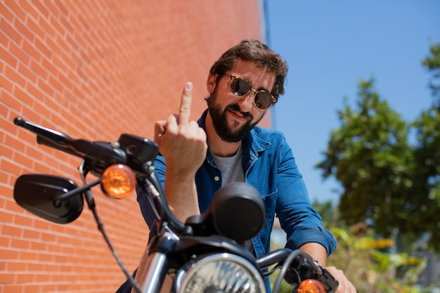 Young anger man on a motorbike