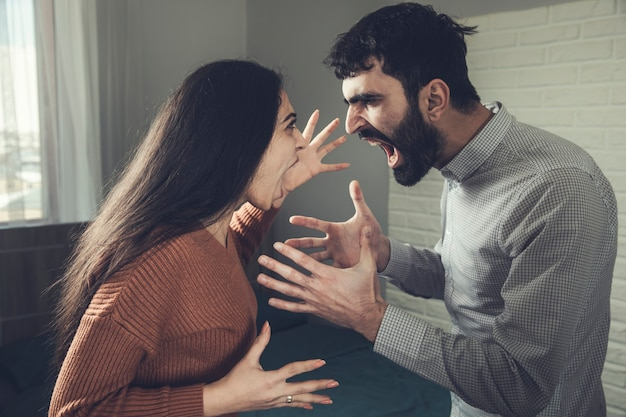 Young angry couple shouting at each other