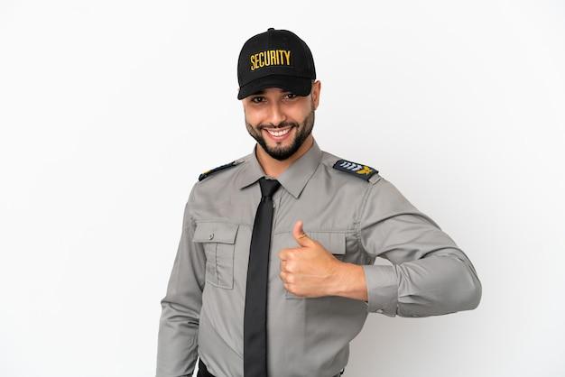 Молодой арабский мужчина, изолированные на белом фоне, показывает палец вверх жест