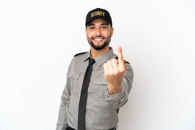 Young arab man isolated on white background doing coming gesture