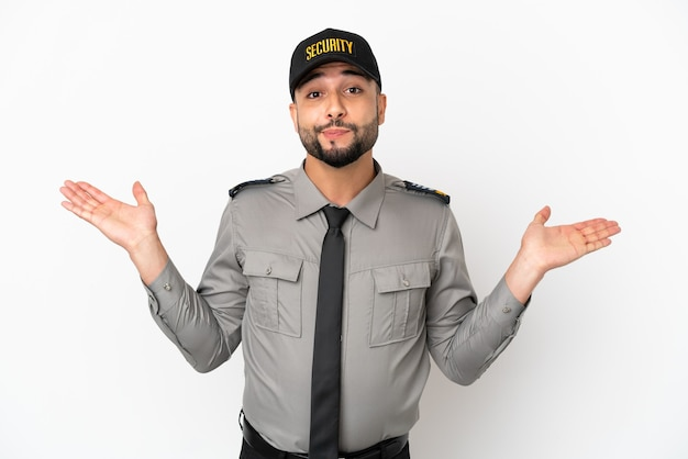 Young arab man isolated on white background having doubts while raising hands