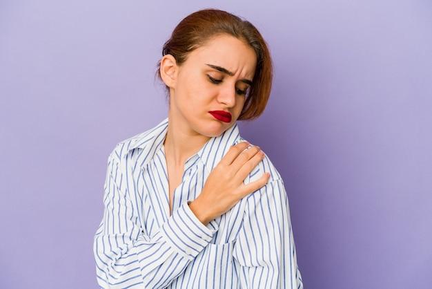 Young arab woman having a shoulder pain