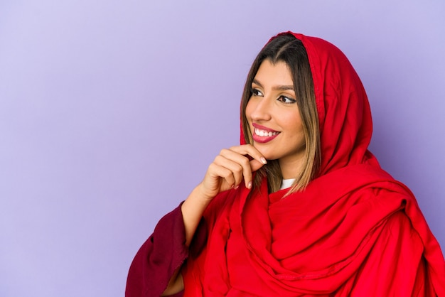 Young arab woman thinking isolated