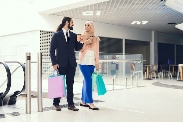 Young arabian couple shopping in modern mall.