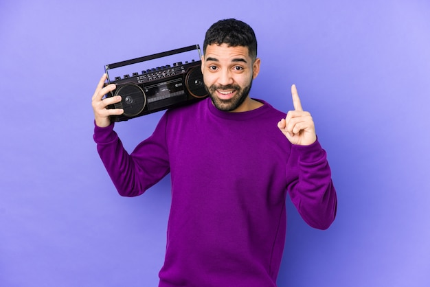 Young arabian man holding a radio cassette