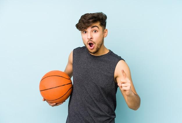 Young arabian man playing basket having an idea