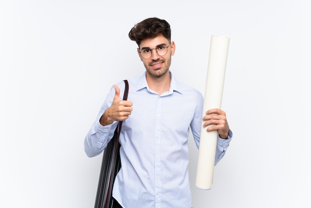 Young architect man giving a thumbs up gesture