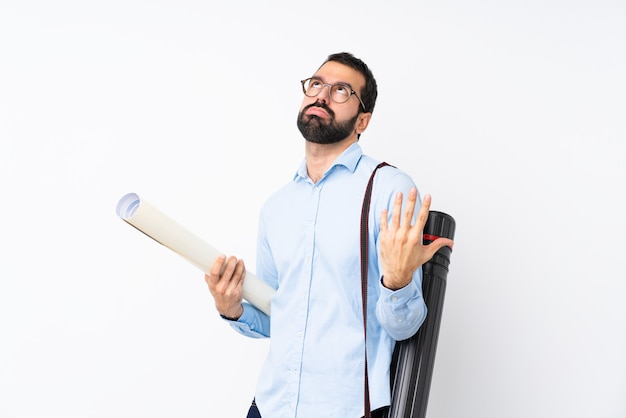 Young architect man with beard over isolated white background frustrated by a bad situation
