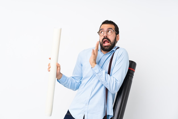 Young architect man with beard over isolated white  nervous and scared