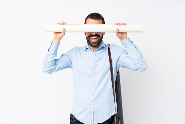 Young architect man with beard over isolated white wall covering eyes by hands