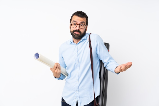 Young architect man with beard over isolated white wall making doubts gesture