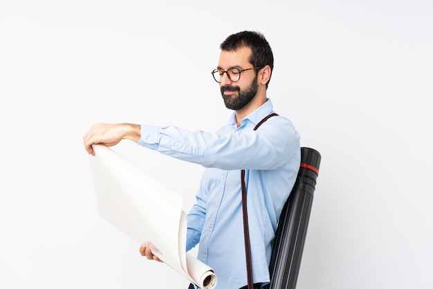 Young architect man with beard over isolated white