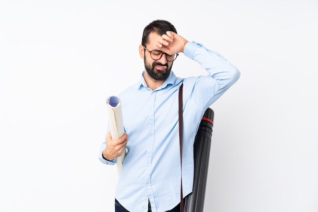 Young architect man with beard with tired and sick expression
