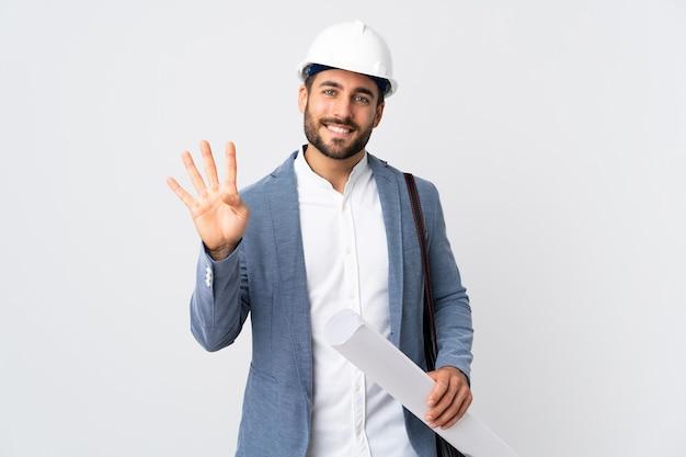 젊은 건축가 남자 헬멧과 지주 청사진 행복하고 손가락으로 4 세 흰색 배경에 고립