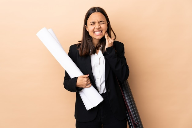 Young architect woman holding blueprints