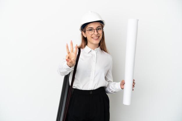 헬멧과 고립 된 청사진을 들고 젊은 건축가 여자