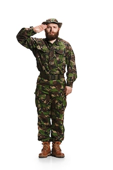 Young army soldier wearing camouflage uniform isolated on white
