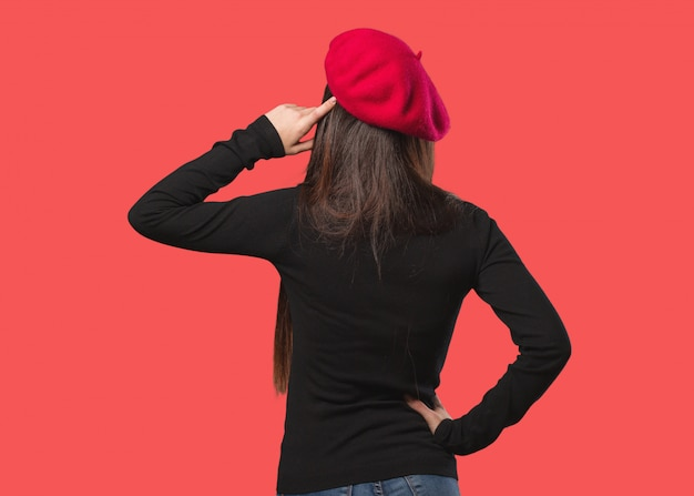 Young artist woman from behind thinking about something