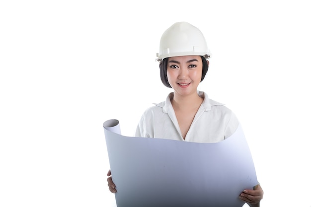 Young asia woman civil engineer holding plan drawing  looking forward and thinking