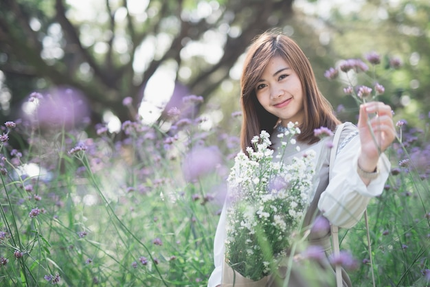 Young asia woman with flowers