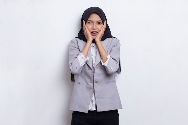 Young asian beautiful muslim woman shocked covering mouth with hands for mistake secret concept