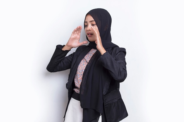 Young asian beautiful muslim woman shouting and yelling announcing isolated on white background