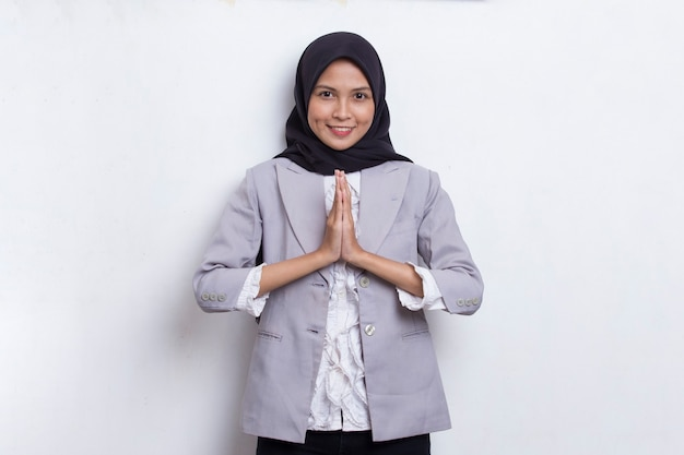 Young asian beautiful muslim woman show welcome gesture isolated on white background