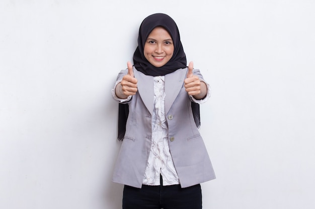 Young asian beautiful muslim woman with ok sign gesture tumb up isolated on white background