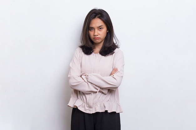 Young asian beautiful woman angry emotional shouting and screaming on white background