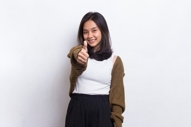 Young asian beautiful woman with ok sign gesture tumb up isolated on white background