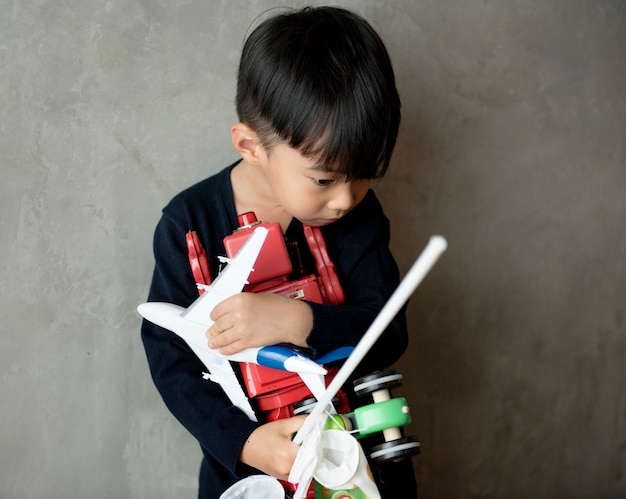 Young asian boy innocence adorable playing toy