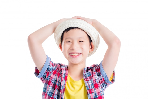 Young asian boy wearing hat and smiles over white background