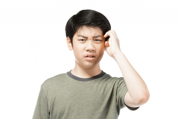 Young asian boy over white background, be upset; have a bad temper emotional.