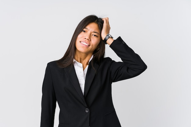 Young asian business woman being shocked, she has remembered important meeting.