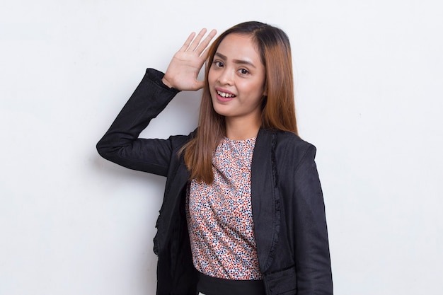 Young asian business woman covering both ears with hands isolated on white background