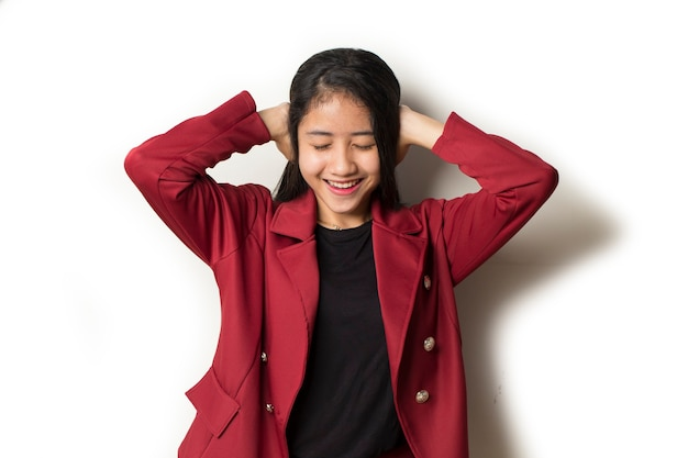 Young asian business woman a covers her ears