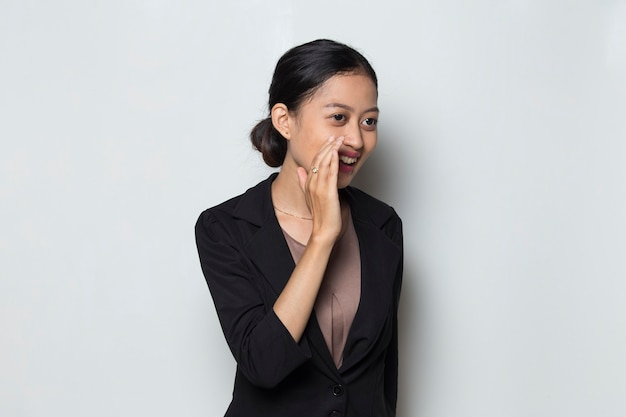 Young asian business woman shouting  yelling and announcing