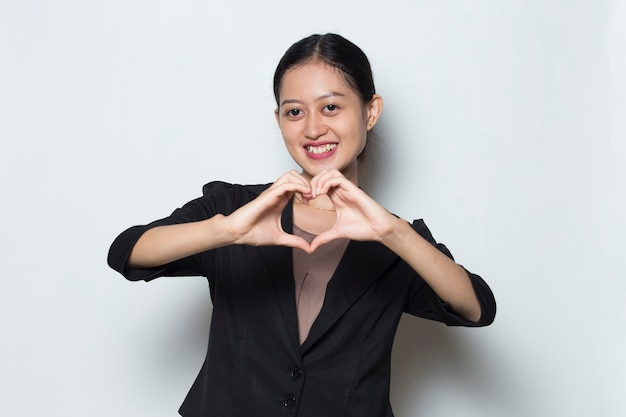 Young asian business woman showing heart sign