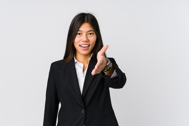 Young asian business woman stretching hand in greeting gesture.