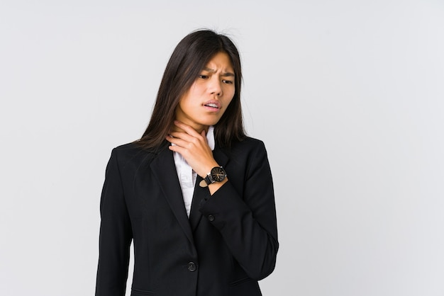 Young asian business woman suffers pain in throat due a virus or infection.
