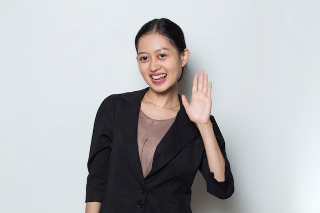 Young asian business woman welcoming guests gesture on white background