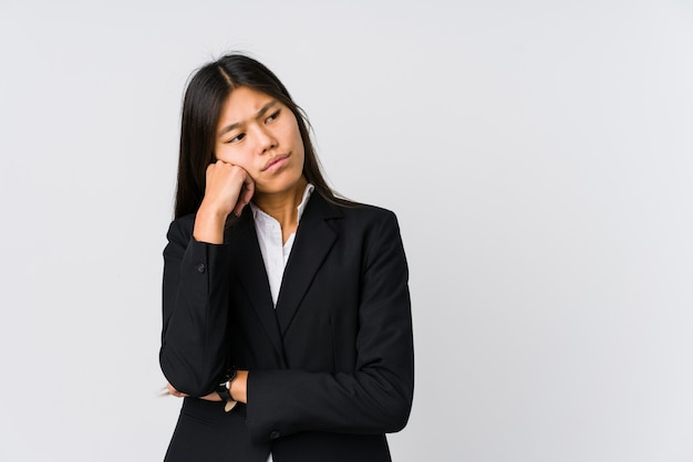 Young asian business woman who feels sad and pensive, looking at copy space.