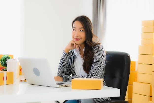 Young asian business woman working from home with laptop