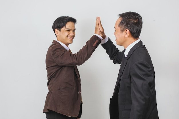 Young asian businessman doing high five with partner
