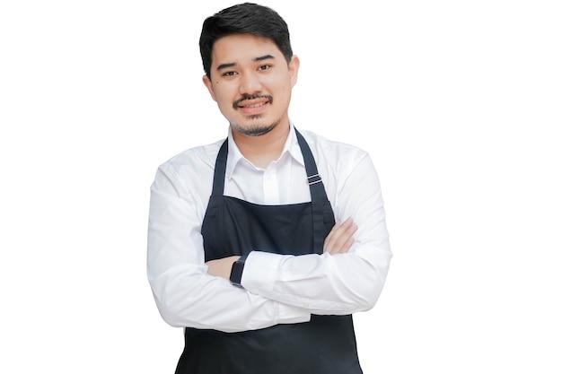 Молодой азиатский бизнесмен владелец скрестил руку на белом фоне для дизайна рекламы и концепции баннера